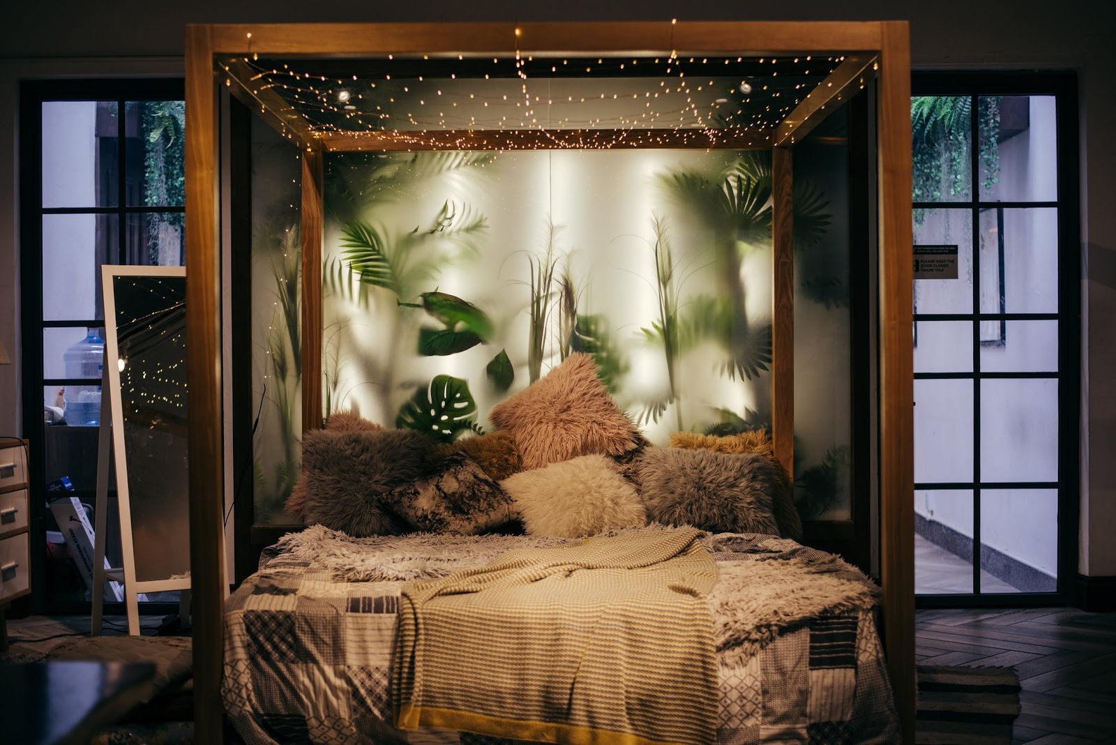 Beautiful scenic bedroom with pants and fairy lights