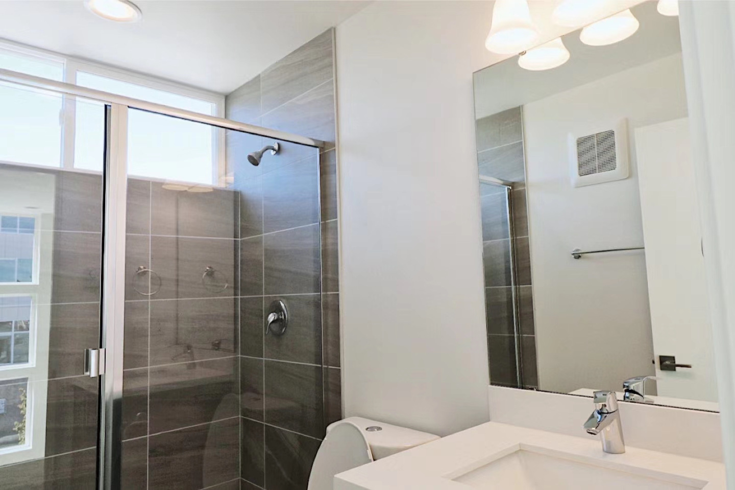 large restroom with glass shower