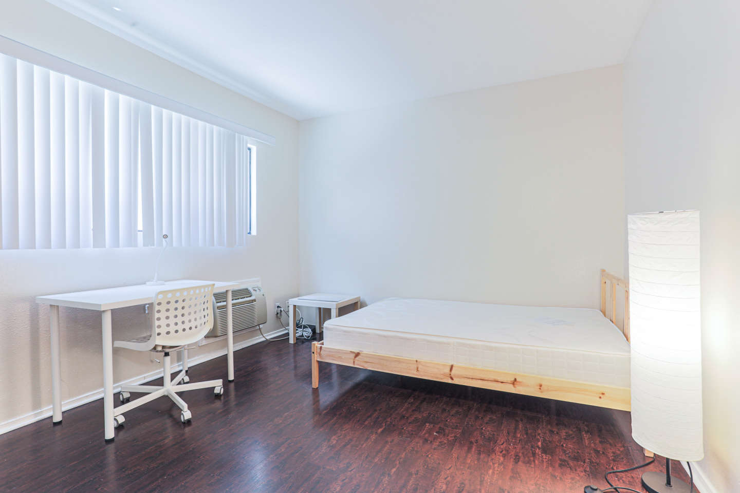Tripalink Property, Comfortable wood paneled bedroom, USC student housing with bed and furniture