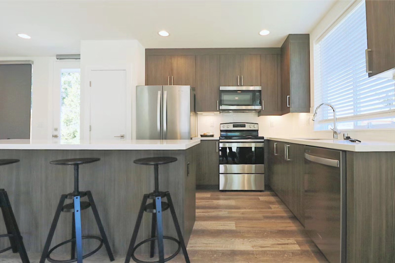 black steel barstools, big modern kitchen
