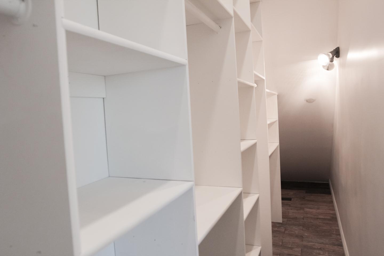 huge closet, built-in white cupboards, Dark hardwood floors