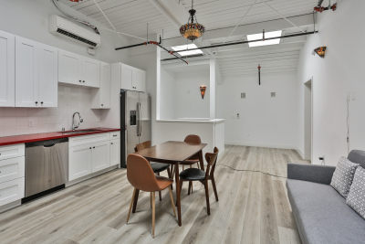 Modern Kitchen with Brown Table, Silver Appliances