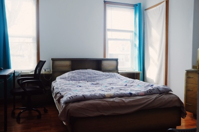 two windows, bedroom with sheer curtains