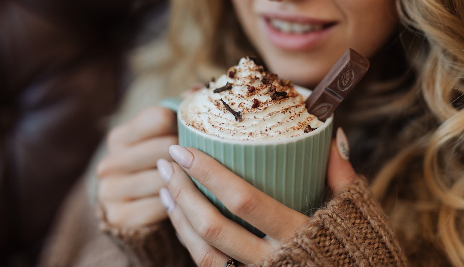 woman holding a beautiful cup of hot cocoa