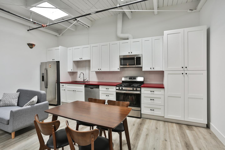 kitchen, grey sofas, brown kitchen table