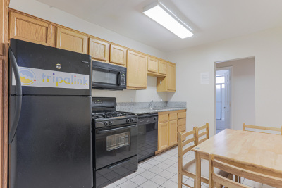 Tripalink Property ,Beautiful living room USC Student Housing with dining table and Microwave