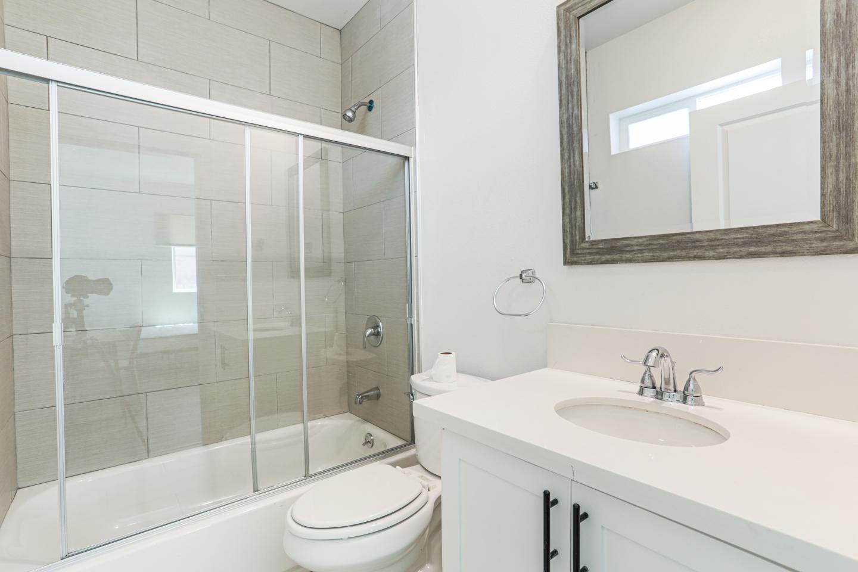 clean bright restroom, Glass shower