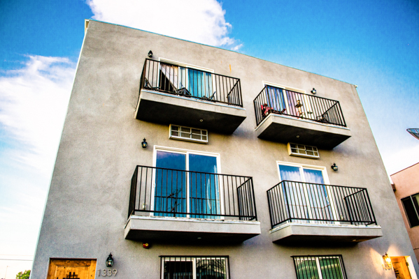 Outside view of apartment showing four balconies