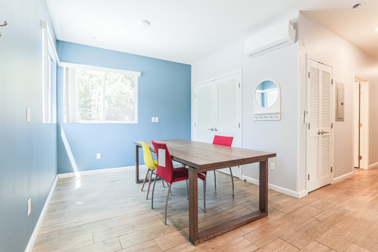 white and blue living room with dining table