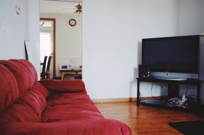 large red couch, black flat screen tv