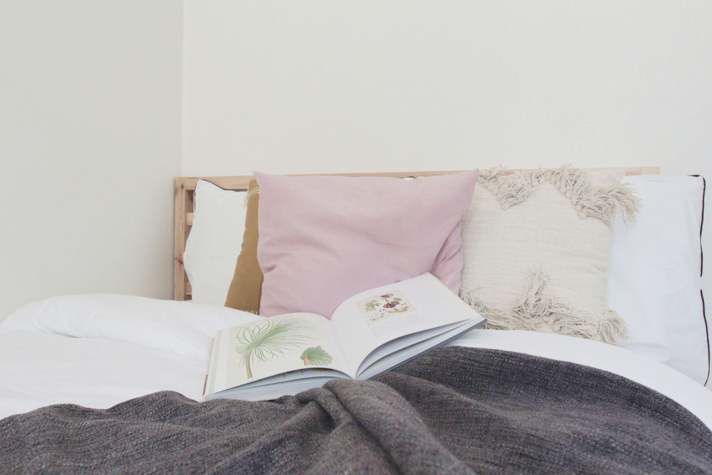 Pink and white bed, white comforter