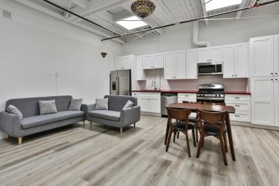 two grey sofas. large kitchen