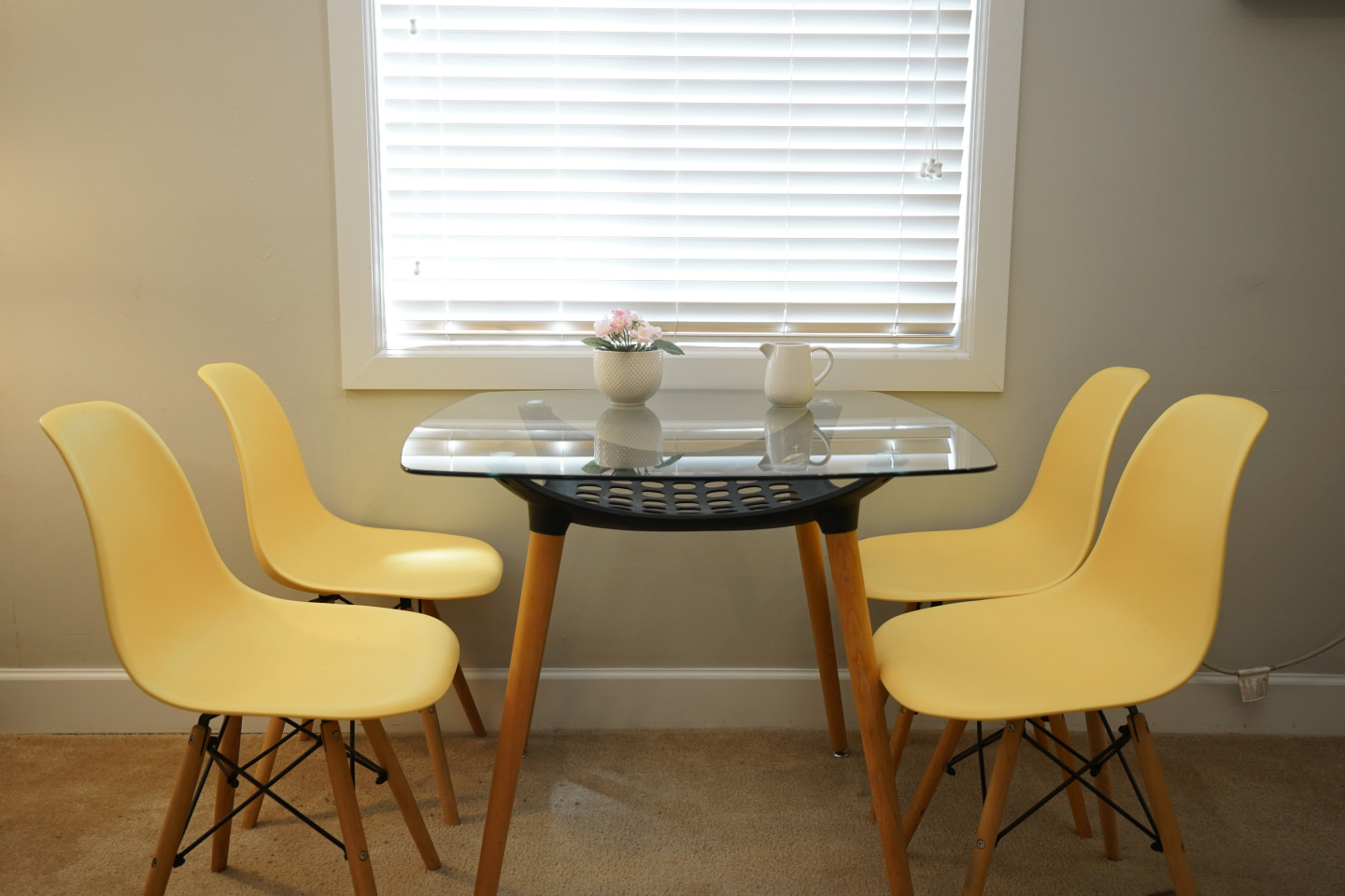 yellow chair with clean and bright dining table