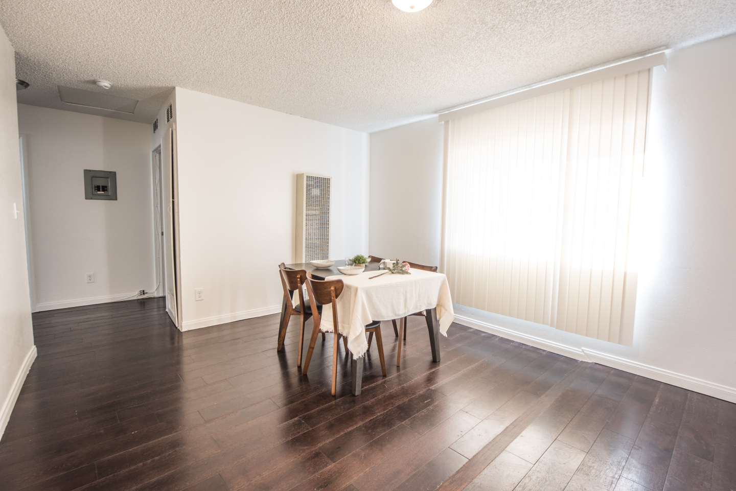 Small dining room table centered in livingroom