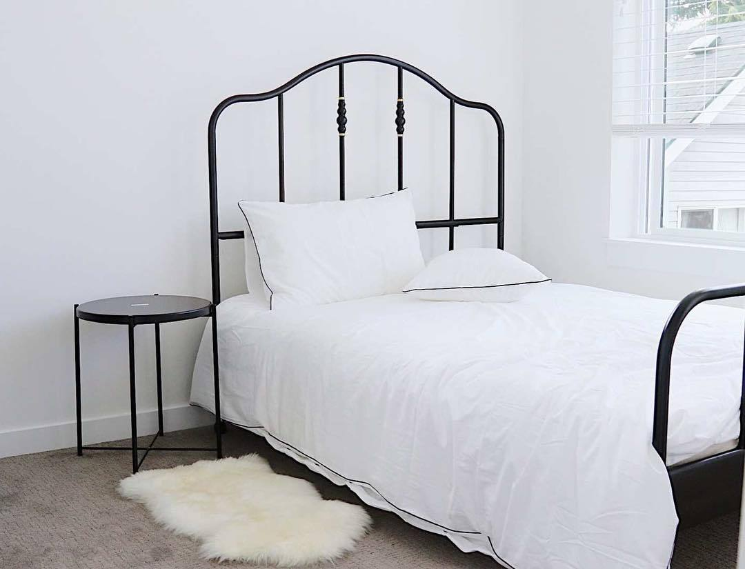 white bed with rail frame