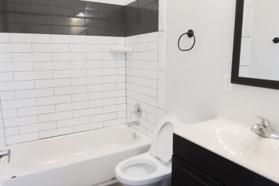 white bathroom with White and Grey tile