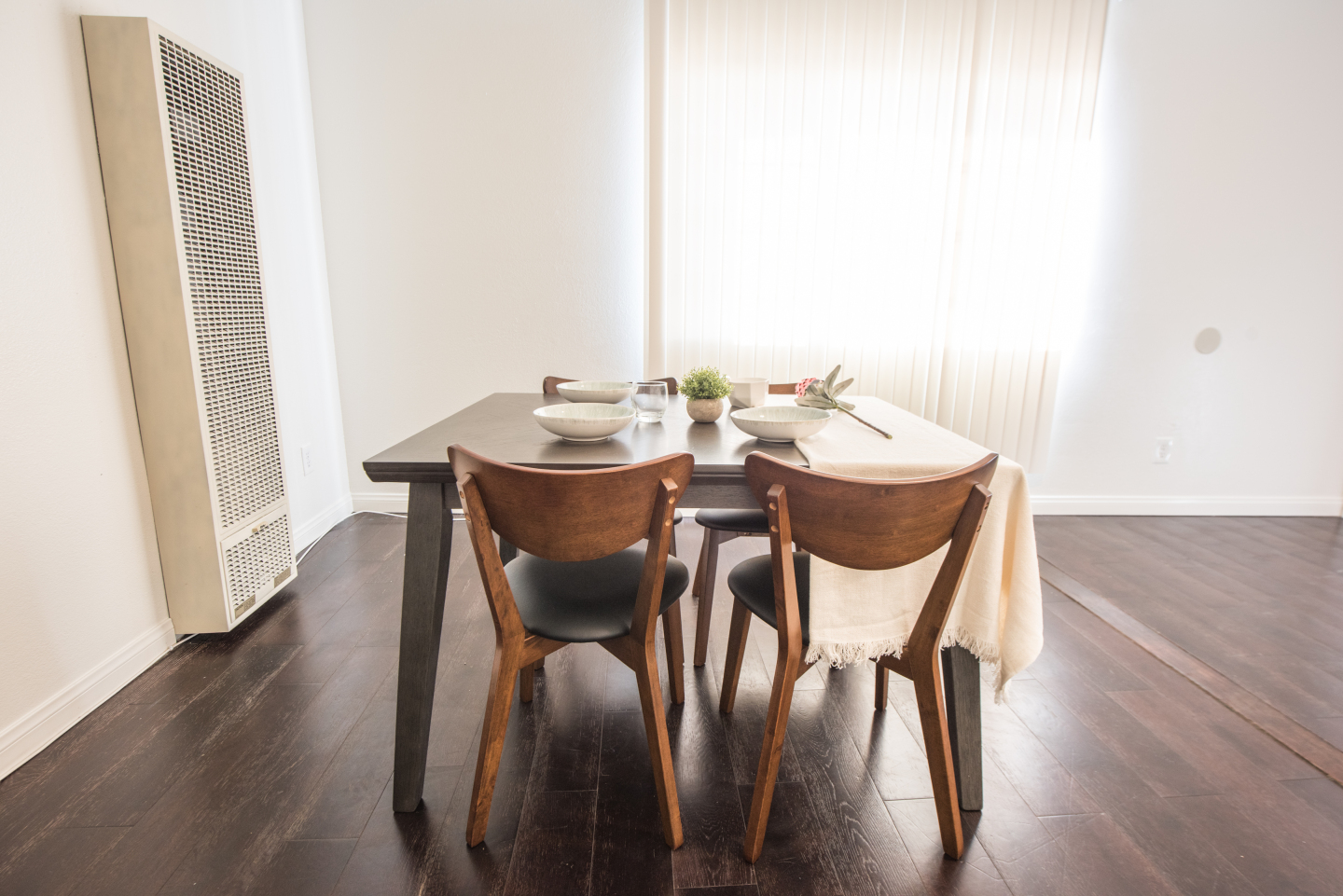 brown dining table set up with decorations
