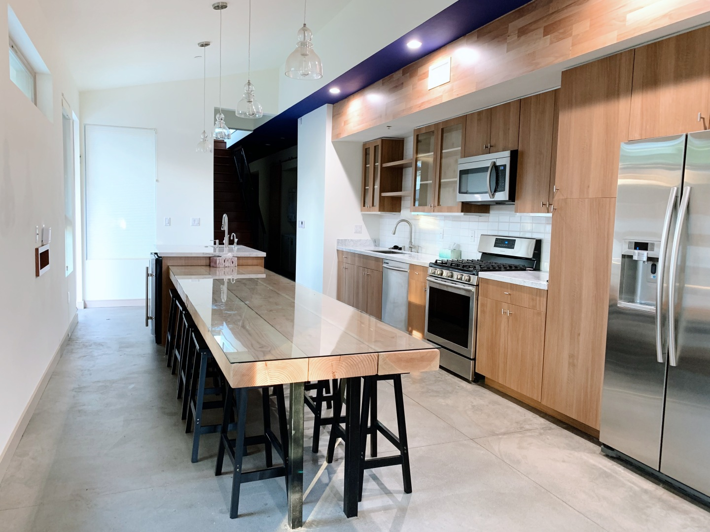 very large modern kitchen with island, cream wood