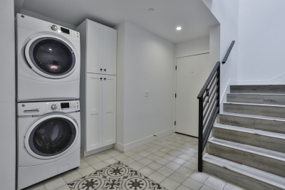 Stacked Washer and Dryer near stairs