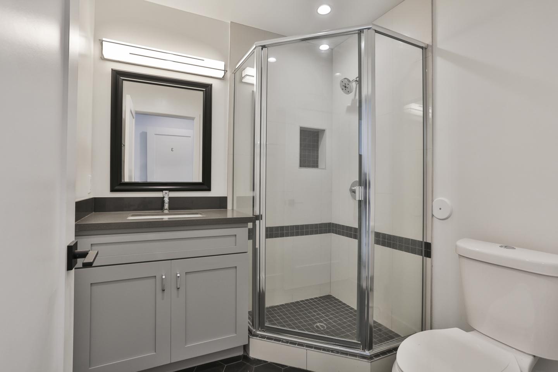 clean bathroom, large glass walk in shower