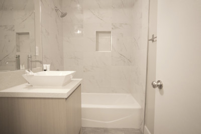 modern and clean bathroom with tub