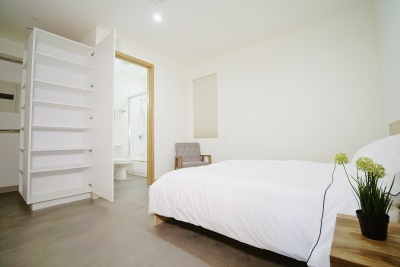 bright room with large white bed
