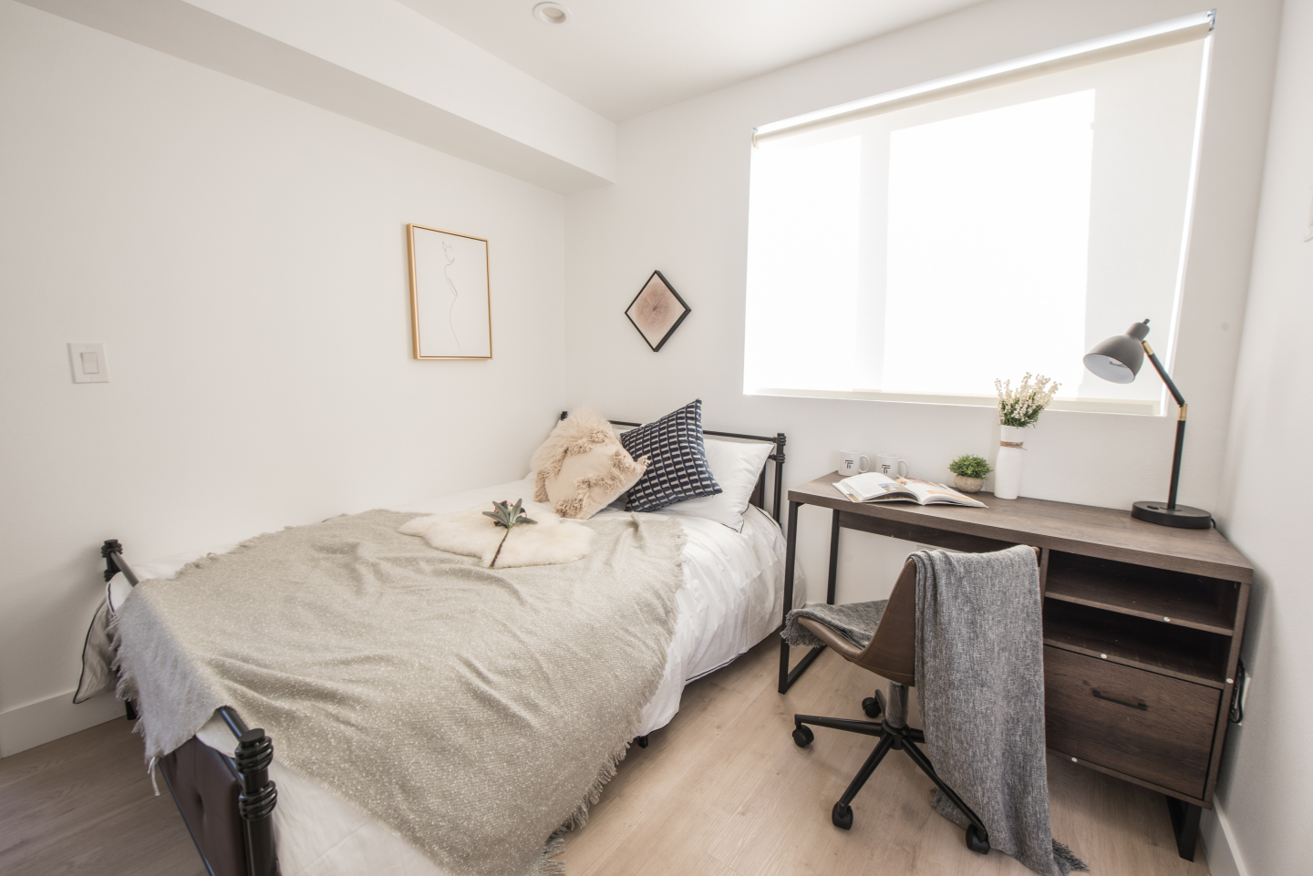 Bedroom with wood floors and desk area