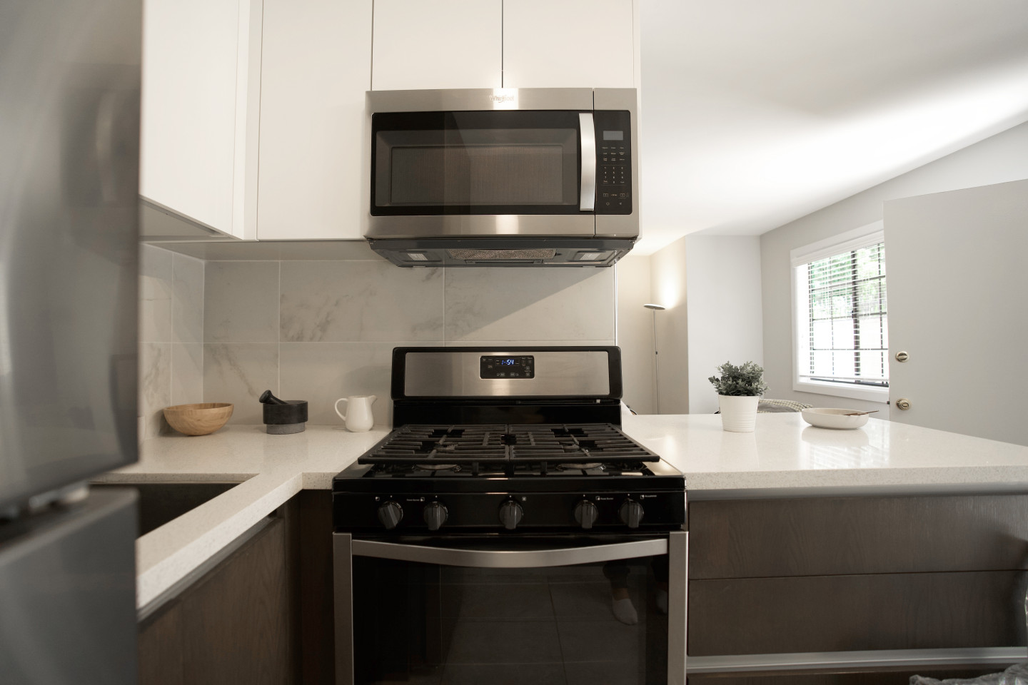 modern kitchen furnished with microwaves and oven