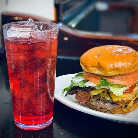 A burger and a drink on a table, Place: Champs Diner