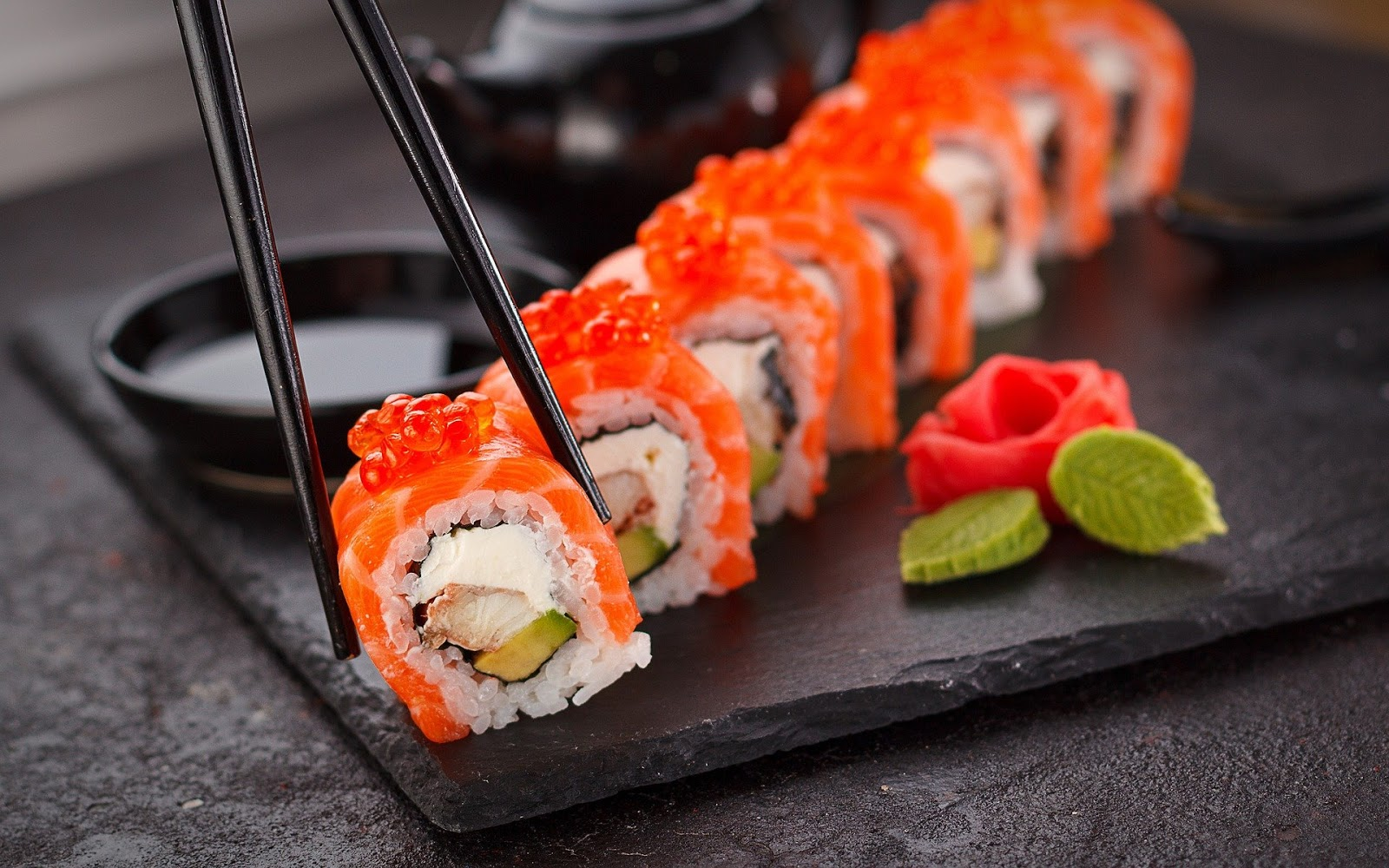 sushi on a black board