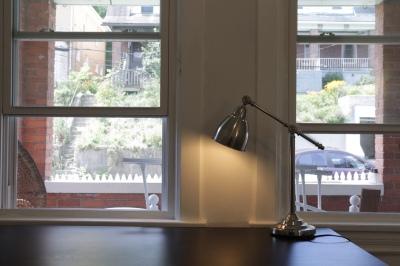 silver lamp on black computer desk