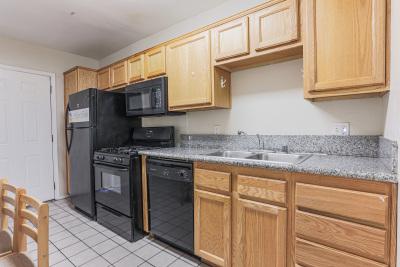 Tripalink Property, Kitchen, black appliances, USC student housing, Bright color