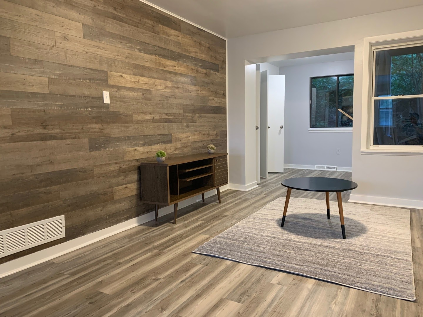 Tripalink with hardwood flooring and walls