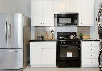 kitchen with black microwave and silver stove