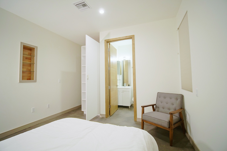 bedroom, open door to restroom
