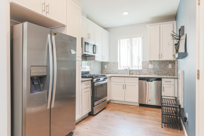bright kitchen with silver appliances