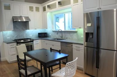 Kitchen with Silver appliances,Black dining room table