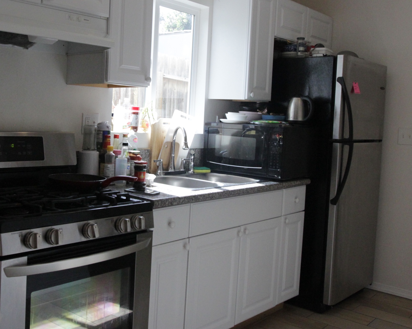 kitchen with black microwave and black fridge