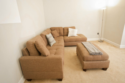 cozy living room with beige sofa and sofa table
