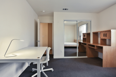 bedroom, large closet mirror, white desk and small desk lamp