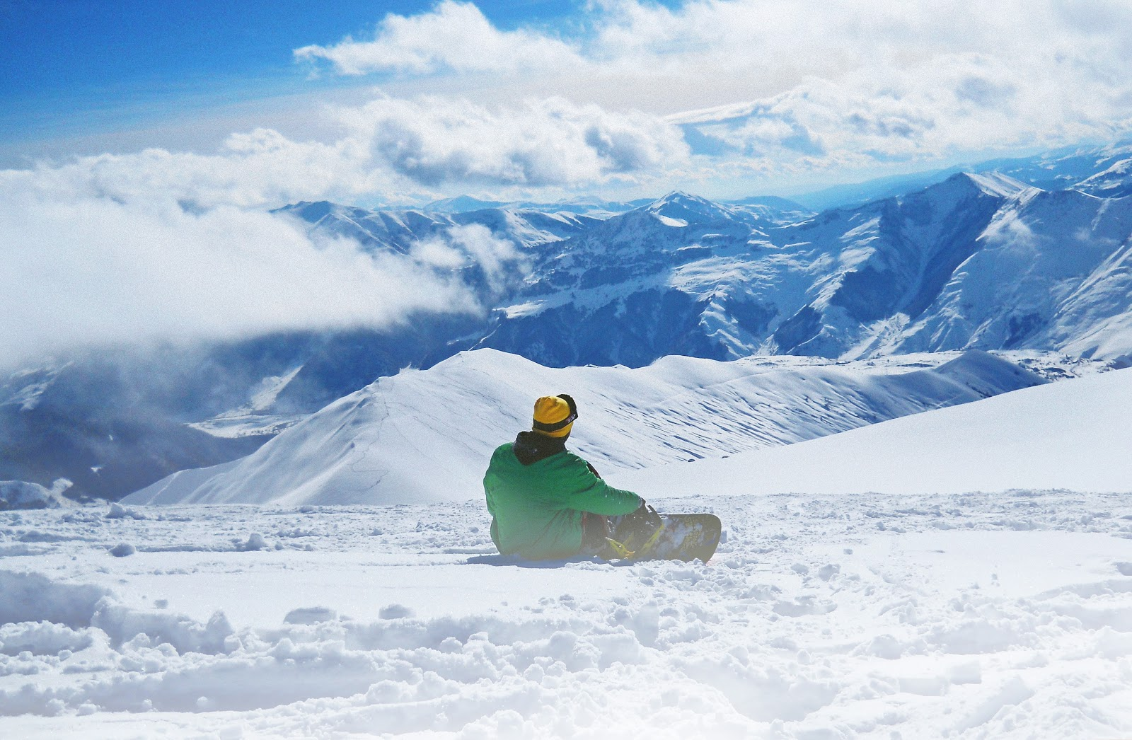 person sitting with snowboarding equipment on big bear mountain