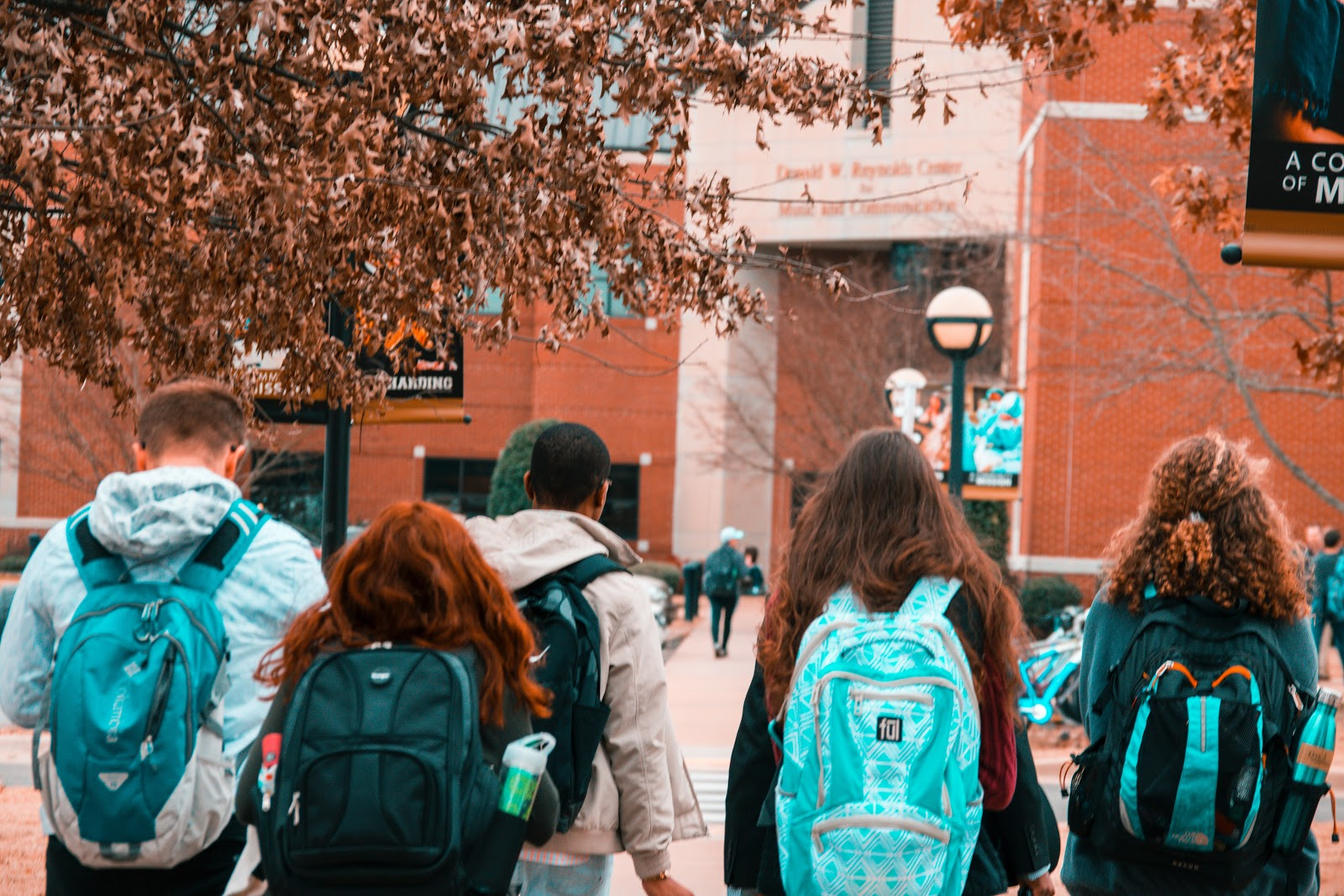 Group of USC students with backpacks walking on the campus
