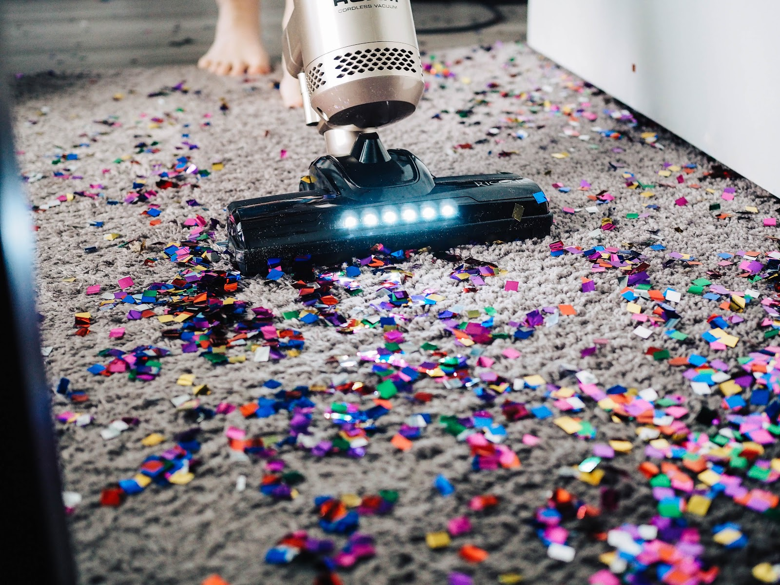 vacuuming really messy carpet with confetti