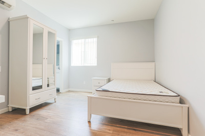 beautiful and cozy bedroom with cabinet and bed