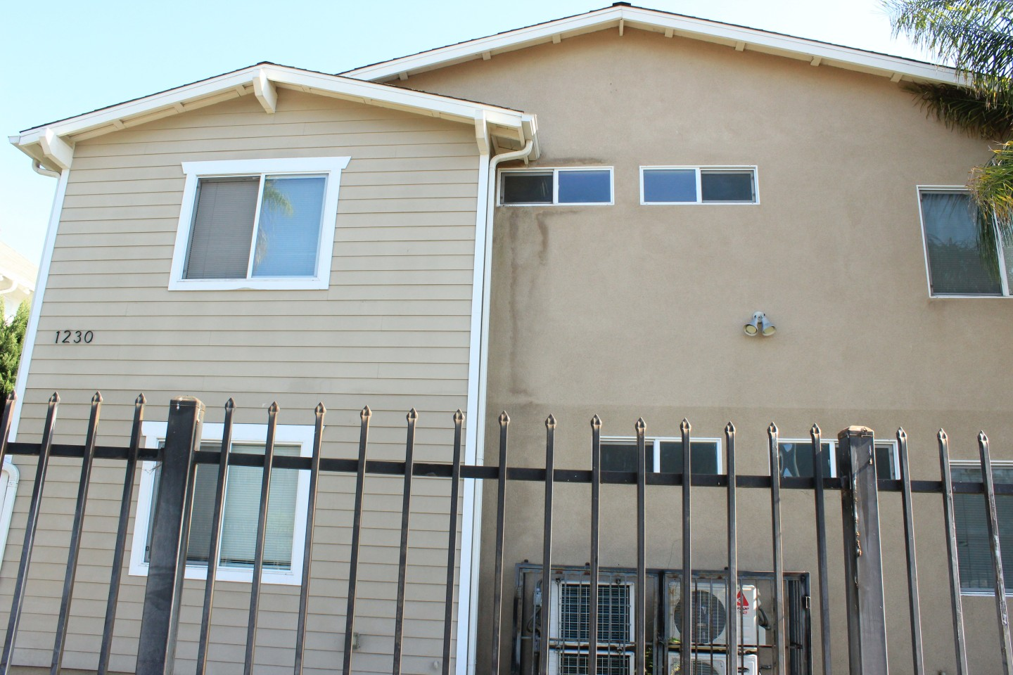 Tripalink Property, cozy house with beige exterior wall, black fence
