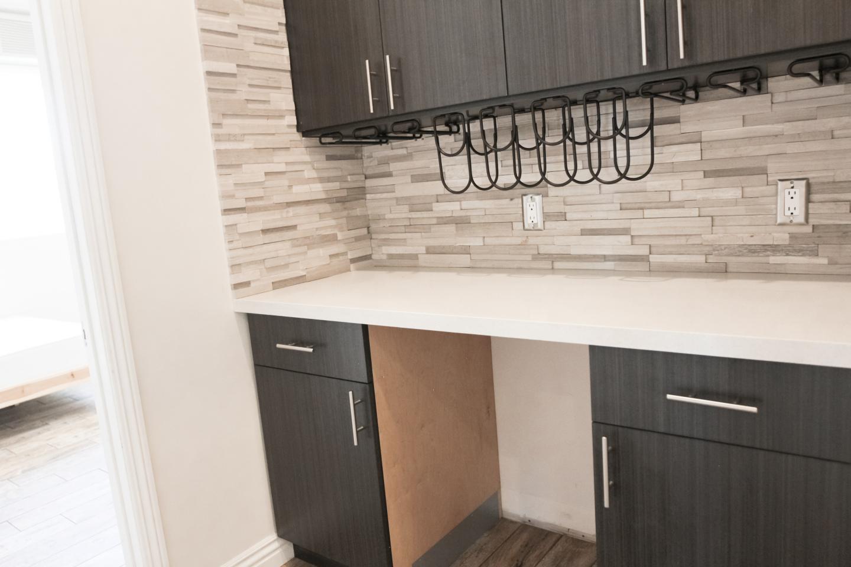Dark stained wood kitchen cabinets