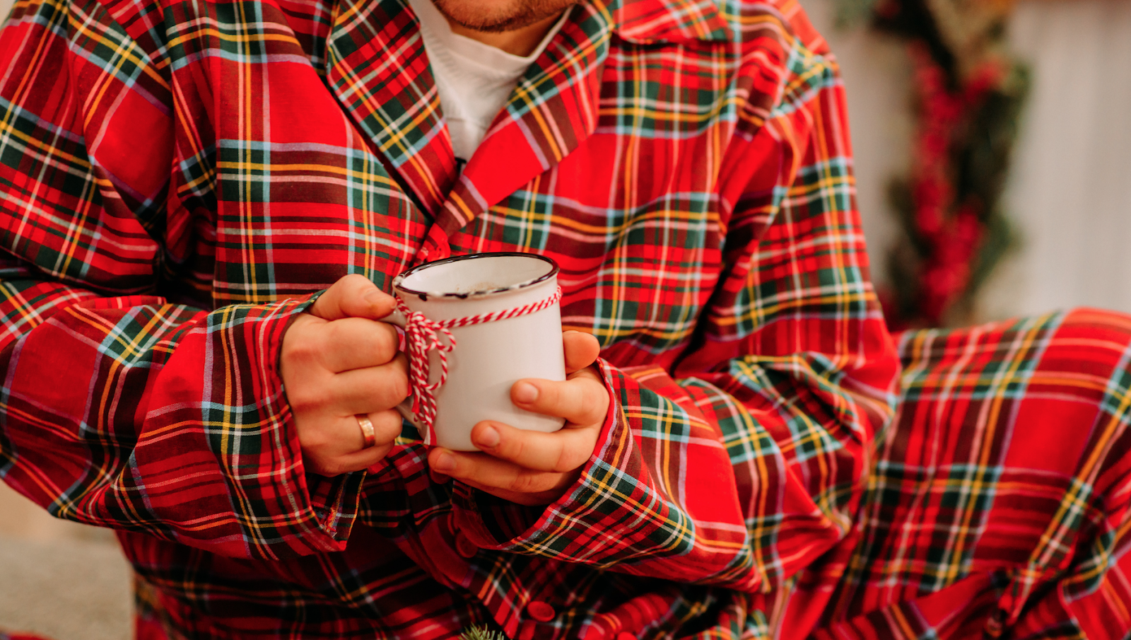 a person in pajama set dressing holding tea