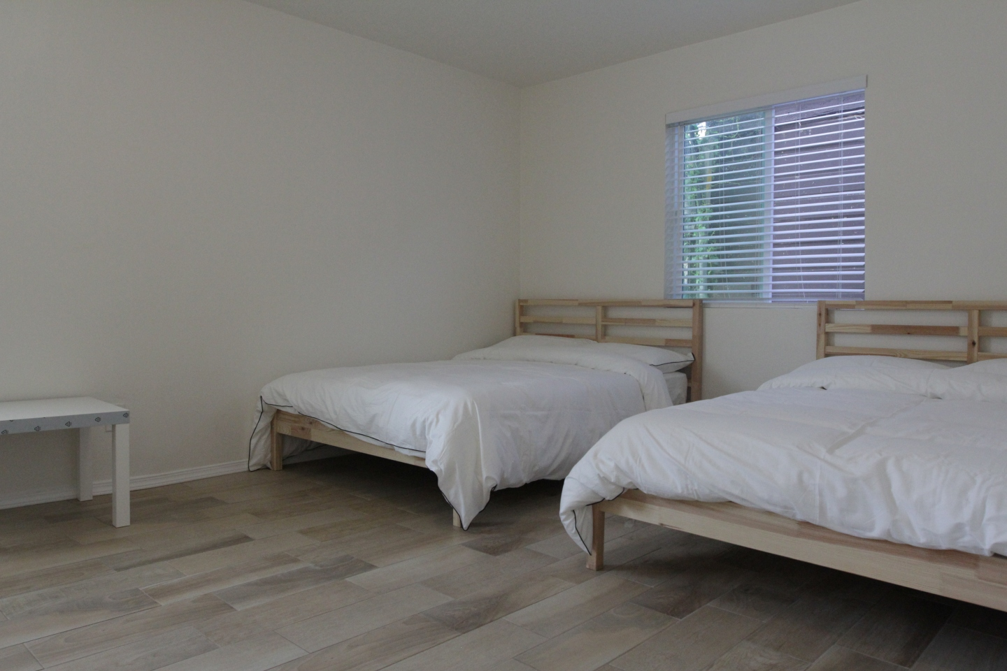 two white beds in co-living space