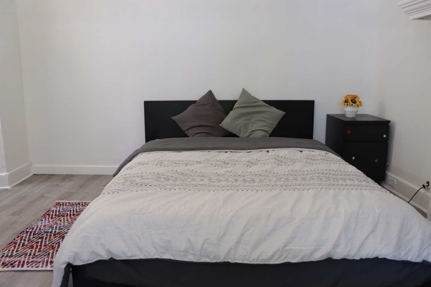 clean room, small bed with black bed frame