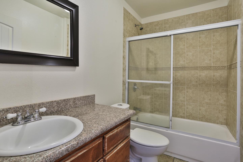 Clean restroom with glass shower door